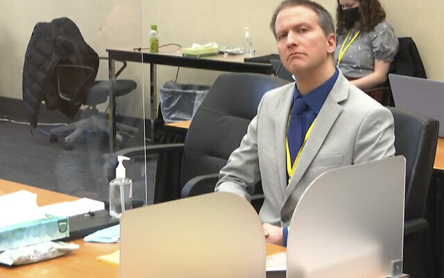 In this image from video, former Minneapolis police Officer Derek Chauvin listens as his defense attorney Eric Nelson gives closing arguments as Hennepin County Judge PeterCahill preside on April 19, 2021, in the trial of Chauvin at the Hennepin County Courthouse in Minneapolis. (Court TV via AP, Pool)