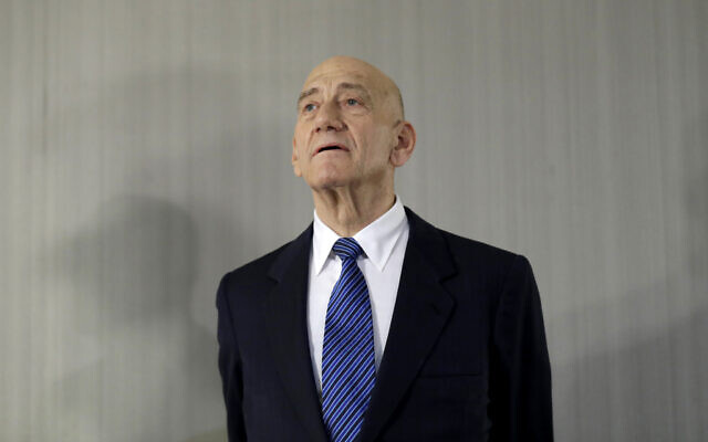 In this Feb. 11, 2020, photo, former prime minister Ehud Olmert takes questions from reporters after a news conference in New York. (AP Photo/Seth Wenig)