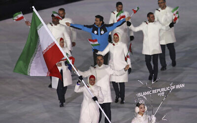 Samaneh Beyrami Baher carries the flag of Iran during the opening ceremony of the 2018 Winter Olympics in Pyeongchang, South Korea, February 9, 2018. (AP Photo/Michael Sohn, File)