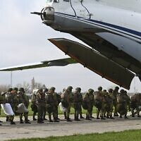 Russian paratroopers load into a plane for airborne drills during maneuvers in Taganrog, Russia, April 22, 2021. (AP Photo)