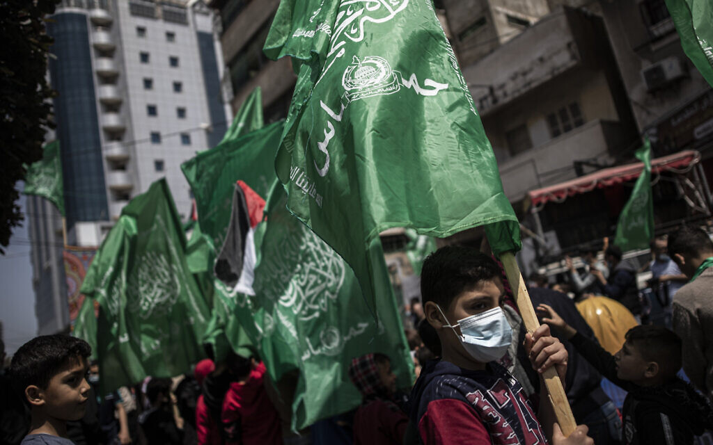 Palestinians holding Hamas movement green flags attend a protest in solidarity with Muslim worshipers in Jerusalem, in Gaza City, April 23, 2021. (AP Photo/Khalil Hamra)