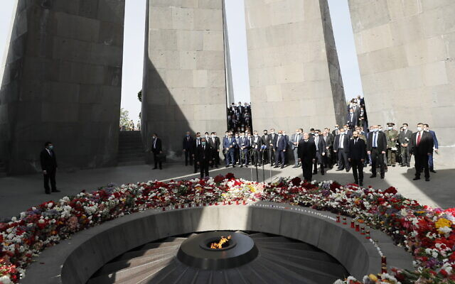 Armenian Prime Minister Nikol Pashinyan, center, attends a memorial service at the monument to the victims of mass killings by Ottoman Turks, to commemorate the 106th anniversary of the massacre, in Yerevan, Armenia, Saturday, April 24, 2021. (Tigran Mehrabyan/PAN Photo via AP)
