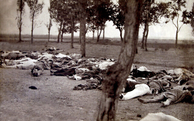 The bodies of deportees from Van who died of typhus and various other diseases, pictured in a forest near the Mother See of Etchmiadzin, about 25 kilometers (15 miles) from the Armenian capital of Yerevan, in the summer of 1915. (Armenian Genocide Museum/PAN Photo via AP)