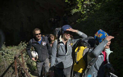 Members of the French team that participated in the 'Deep Time' study, emerge from the Lombrives Cave after 40 days underground in Ussat les Bains, France, April 24, 2021. (Renata Brito/AP)