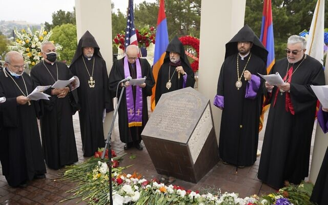 Religious leaders sing at a ceremony remembering the victims of the Armenian Genocide at the Montebello Armenian Genocide Monument in Montebello, California, Saturday, April 24, 2021 (AP Photo/Damian Dovarganes)