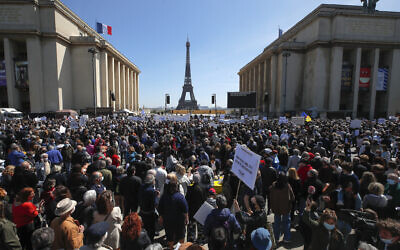 People stage a protest organized by Jewish associations, who say justice has not been done for the killing of French Jewish woman Sarah Halimi, at Trocadero Plaza near Eiffel Tower in Paris, April 25, 2021. (AP Photo/Michel Euler)