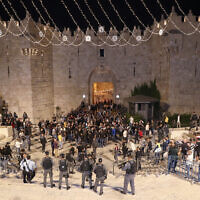 israeli police remove a series of barriers that prevented crowds gathering at the Old City's Damascus Gate, April 26, 2021. (AP Photo/Ariel Schalit)