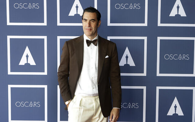 Sacha Baron Cohen poses for a photo during a screening of the Oscars on April 26, 2021 in Sydney, Australia. (AP Photo/Rick Rycroft, Pool)