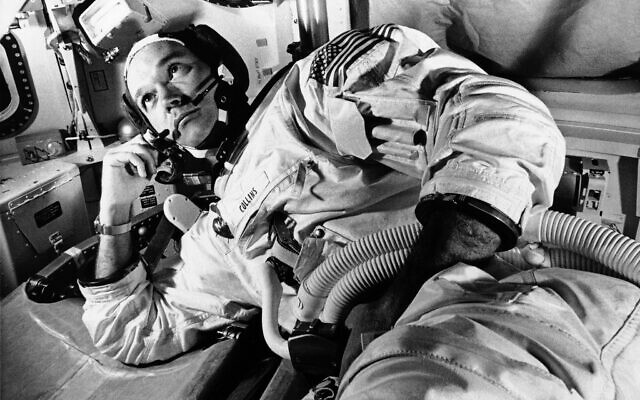 In this June 19, 1969 file photo, Apollo 11 command module pilot astronaut Michael Collins takes a break during training for the moon mission, in Cape Kennedy, Florida. (AP Photo/File)