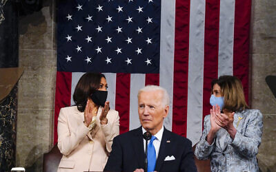 US Vice President Kamala Harris and House Speaker Nancy Pelosi look at each other as US President Joe Biden addresses a joint session of Congress, April 28, 2021, in the House Chamber at the US Capitol in Washington. (Melina Mara/The Washington Post via AP, Pool)