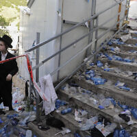 Ultra-Orthodox Jews at the scene of a deadly stampede during Lag BaOmer festival at Mt. Meron in northern Israel, April 30, 2021 (AP Photo/Sebastian Scheiner)