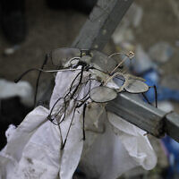 Broken glasses are seen at the site of a stampede during Lag B'Omer festivities at Mt. Meron in northern Israel, April 30, 2021 (AP Photo/Sebastian Scheiner)