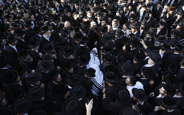 Mourners carry the body of Shraga Gestetner, a Canadian singer who died during Lag BaOmer celebrations at Mt. Meron in northern Israel, at his funeral in Jerusalem on Friday, April 30, 2021.  (AP Photo/Ariel Schalit)