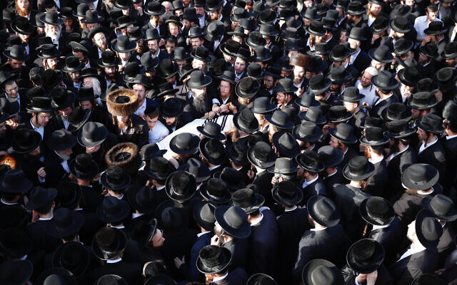 Mourners carry the body of Shraga Gestetner, a Canadian singer who died during Lag B'Omer celebrations at Mt. Meron in northern Israel, at his funeral in Jerusalem on Friday, April 30, 2021.  (AP Photo/Ariel Schalit)
