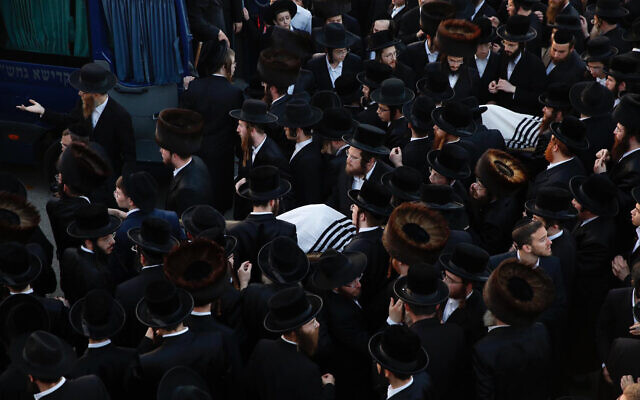 Ultra-Orthodox men carry the bodies of Moshe Englard, 14, and his brother, Yehoshua, 9, who died during Lag B'Omer celebrations at Mt. Meron in northern Israel, in Jerusalem on Friday, April 30, 2021. (AP Photo/Ariel Schalit)