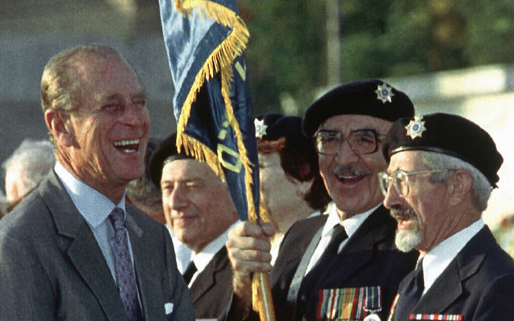 Britain's Prince Philip jokes with British WWII veterans Nathan Kohaen, right, and Arthur Stark, who immigrated to Israel, during a ceremony at the Commonwealth War Cemetery in Ramle, Israel, on Oct. 30, 1994, where he came to lay a wreath (AP Photo)