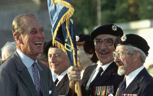 Britain's Prince Philip jokes with British WWII veterans Nathan Kohaen, right, and Sol Jacobs, who immigrated to Israel, during a ceremony at the Commonwealth War Cemetery in Ramle, Israel, on Oct. 30, 1994, where he came to lay a wreath (AP Photo)