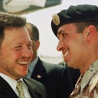 Jordan's King Abdullah II laughs with his half-brother, then-crown prince Hamzah Bin Hussein, right, on April 2, 2001 (AP Photo/Yousef Allan)