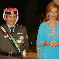 Jordan's then Crown Prince Hamzah, left, with his mother Queen Noor, right, during his wedding ceremony in Amman, Jordan, May 27, 2004. (Hussein Malla/AP)