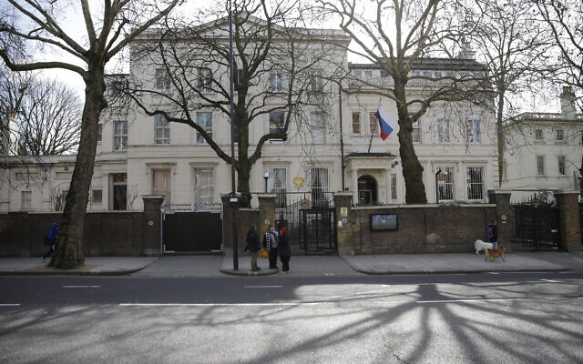 A general view of the part of the Russian Embassy in Kensington, as pedestrian walk past London, March 14, 2018. (AP Photo/Alastair Grant)