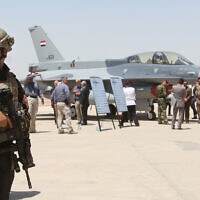 FILE: A member of the Iraqi SWAT team stands guard as security forces and others gather next to a US- made F-16 fighter jet during the delivery ceremony at Balad air base, Iraq, July 20, 2015. (AP Photo/Khalid Mohammed, File)