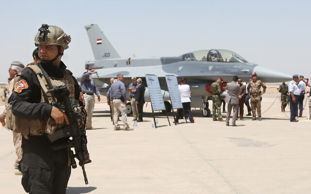 FILE: A member of the Iraqi SWAT team stands guard as security forces and others gather next to a US-made F-16 fighter jet during the delivery ceremony at Balad air base, Iraq, July 20, 2015. (AP Photo/Khalid Mohammed, File)