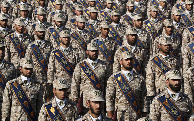 Revolutionary Guard troops attend a military parade marking the 39th anniversary of the start of the Iran-Iraq war, in front of the shrine of the late revolutionary founder Ayatollah Khomeini, just outside Tehran, Iran, on September 22, 2019. (Iranian Presidency Office via AP)