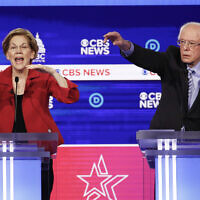 Democratic presidential candidates, Sen. Elizabeth Warren, D-Mass., left, and Sen. Bernie Sanders, I-Vt., right, participate in a Democratic presidential primary debate at the Gaillard Center on Feb. 25, 2020, in Charleston, S.C., co-hosted by CBS News and the Congressional Black Caucus Institute. (AP Photo/Patrick Semansky)