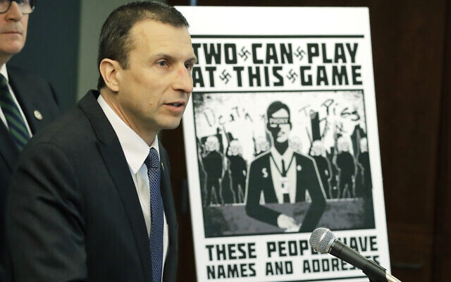 Raymond Duda, FBI Special Agent in Charge in Seattle, speaks as he stands next to a poster that was mailed earlier in the year to the home of Chris Ingalls, an investigative reporter with KING-TV in Seattle, Feb. 26, 2020, during a news conference in Seattle (AP Photo/Ted S. Warren)