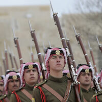 Illustrative -- Jordanian honor guard stands for review at the Royal Palace, in Amman, Jordan, March 2, 2020. (AP Photo/Raad Adayleh)