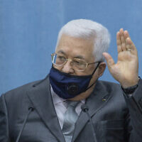 Palestinian President Mahmoud Abbas wears a mask upon his arriving to head the Palestinian leadership meeting at his headquarters, in the West Bank city of Ramallah, May 7, 2020. (AP Photo/Nasser Nasser, Pool)