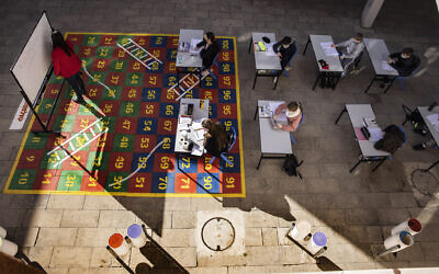 Students take part in a lesson in their makeshift outdoor classroom in the coastal city of Ashkelon, Feb. 11, 2021 (AP Photo/Tsafrir Abayov)