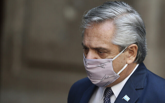 Argentina's President Alberto Fernandez in Mexico City, Tuesday, Feb. 23, 2021, amid the COVID-19 pandemic (AP Photo/Marco Ugarte)