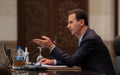 Syrian President Bashar Assad heads a cabinet meeting, in Damascus, Syria, March 30, 2021. (Syrian Presidency Facebook page via AP)