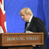 Britain's Prime Minister Boris Johnson leaves after a coronavirus briefing in Downing Street, London, April 5, 2021. (Stefan Rousseau/Pool via AP)