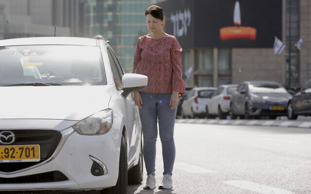 Israelis stand next to their cars as sirens mark a nationwide moment of silence in remembrance of the 6 million Jewish victims of the Holocaust, in Tel Aviv, Israel, April 8, 2021. (AP Photo/Sebastian Scheiner)