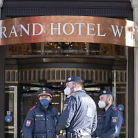 Police officers stay in front of the 'Grand Hotel Wien' in Vienna, Austria, April 9, 2021, where closed-door nuclear talks with Iran take place. (AP Photo/Florian Schroetter)