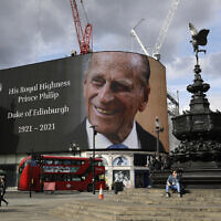 A tribute to Britain's Prince Philip is projected onto a large screen at Piccadilly Circus in London, Friday, April 9, 2021 (AP Photo/Matt Dunham)
