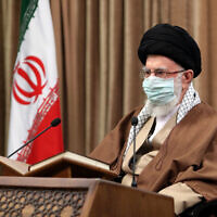 In this picture released by an official website of the office of the Iranian supreme leader, Supreme Leader Ayatollah Ali Khamenei wearing a protective face mask, attends a meeting in Tehran, Iran, Wednesday, April 14, 2021 (Office of the Iranian Supreme Leader via AP)