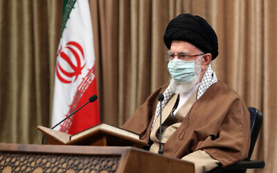 In this picture released by an official website of the office of the Iranian supreme leader, supreme leader Ayatollah Ali Khamenei, wearing a protective face mask, attends a meeting in Tehran, Iran, Wednesday, April 14, 2021 (Office of the Iranian supreme leader via AP)