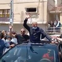Screen capture from video of convicted terrorist Rushdi Hamdan Abu Mukh being welcome at his home town of Baqa al-Gharbiyye after his release from prison, April 5, 2021. (Twitter)