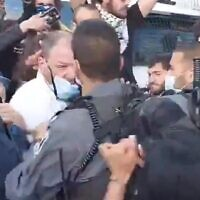 Joint List MK Ofer Cassif after the first punch by a police officer during a protest in East Jerusalem's Sheikh Jarrah neighborhood, April 9, 2021. (Screenshot)