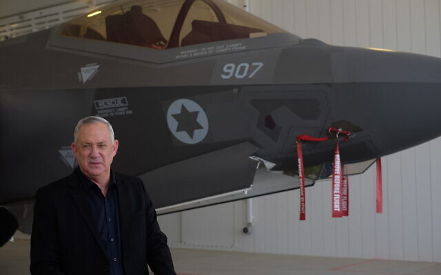 Defense Minister Benny Gantz stands in front of an F-35 fighter jet at the Nevatim air base on April 12, 2021. (Judah Ari Gross/Times of Israel)