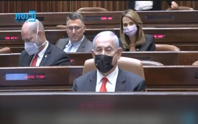 Screen capture from video of Prime Minister Benjamin Netanyahu in the Knesset, April 19, 2021. (Kan)