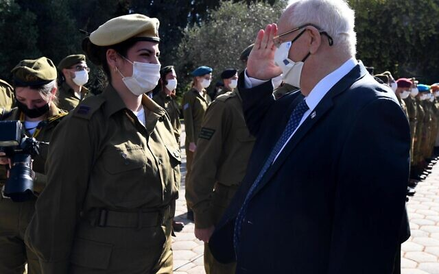 President Reuven Rivlin salutes to a soldier  during an event for outstanding soldiers as part of Israel's 73rd Independence Day celebrations, at the President's Residence in Jerusalem on April 15, 2021. (GPO)