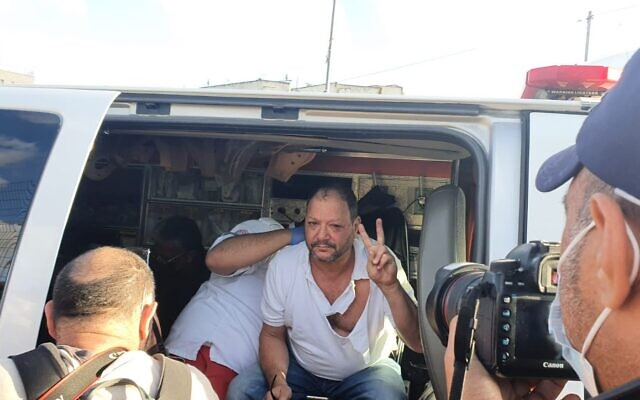 Joint List MK Ofer Cassif after being beaten by police officers during a protest in East Jerusalem's Sheikh Jarrah neighborhood, April 9, 2021. (From the Twitter page of Joint List MK Aida Touma-Sliman)