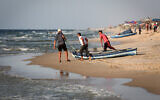 Palestinian fishermen prepare their nets for fishing in the Mediterranean Sea off Rafah in the southern Gaza Strip on September 2, 2020 (Abed Rahim Khatib/Flash90)