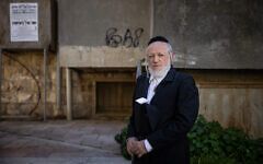 Yehuda Meshi-Zahav, former chairman of Israel's ZAKA rescue unit poses for a picture outside his mother home following her death, in the Ultra orthodox neighborhood of Mea Shearim, Jerusalem, January 19, 2021. (Yonatan Sindel/Flash90)