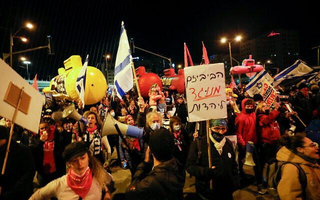 Illustrative: Israelis march in protest against Israeli Prime Minister Benjamin Netanyahu, at the entrance to Jerusalem, January 30, 2021. (Olivier Fitoussi/Flash90)