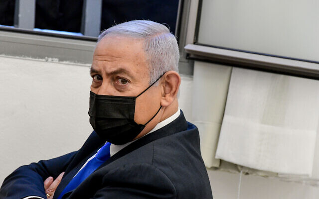 Prime Minister Benjamin Netanyahu seen as he arrives for a court hearing at the Jerusalem District Court on February 8, 2021. (Reuven Kastro/POOLFlash90)